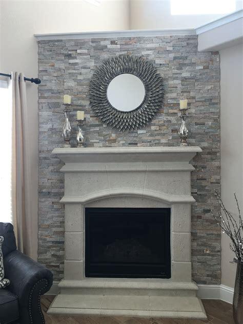 quartz ledger backsplash  cast stone fireplace