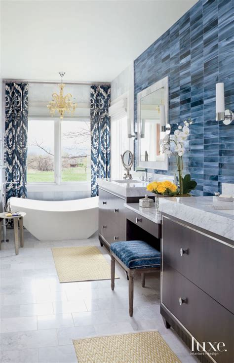 eclectic white bathroom  blue tile accent wall