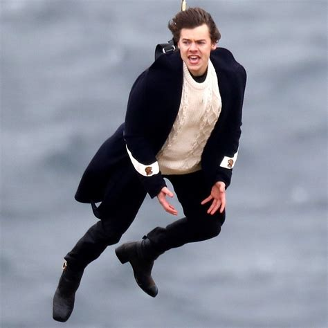 harry styles sweater harry styles hangs from a helicopter wearing gucci coat
