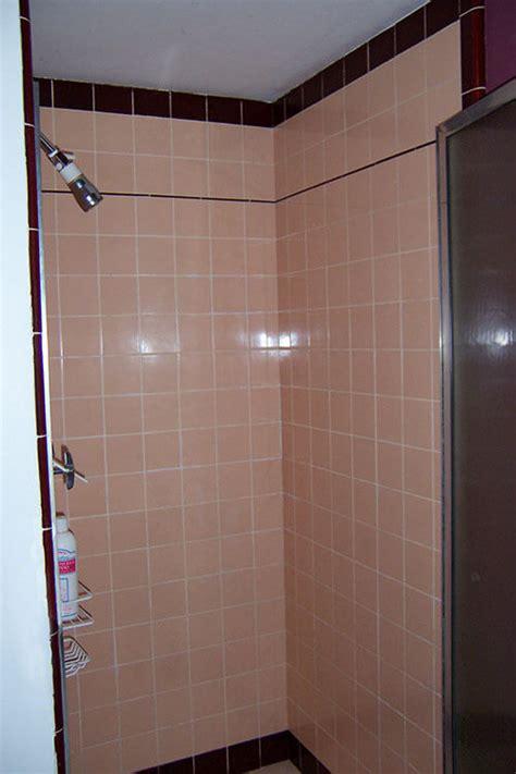 marsha saves  peach tile bathroom    bw