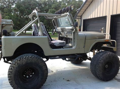 lifted jeep truck jeep cj7 4x4 lifted mud truck rock climbing off road