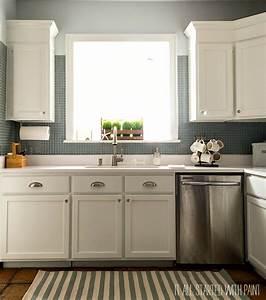 white kitchen cabinets white counter top blue gray backsplash 889