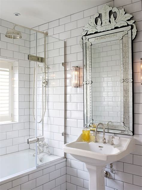sparkling white subway tile bathrooms  black floor