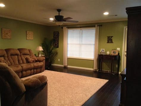 Green Living Room Next by Family Room Living Room With Green Walls Accented With