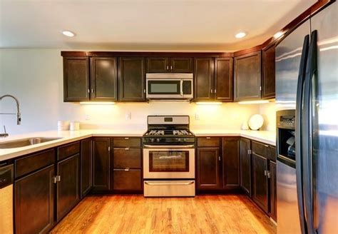 replace or reface kitchen cabinets kitchen cabinet refacing vs replacing bob vila 7736