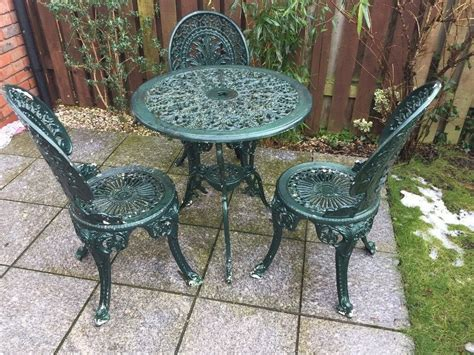 weathered cast alloy patio garden table   chairs