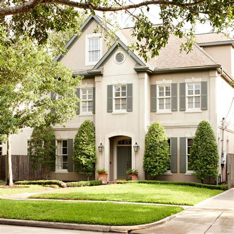gray shutters cottage home exterior bhg
