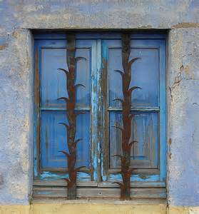 blue window with decorative security bars ii blue window flickr photo