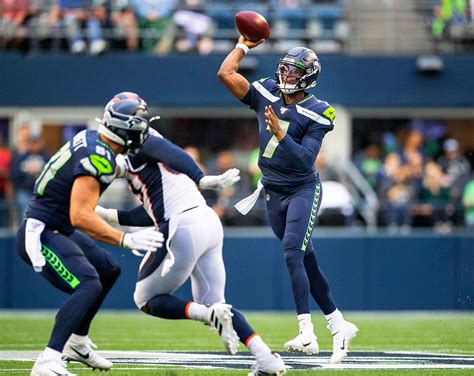 russell wilson watches paxton lynch outplay geno smith