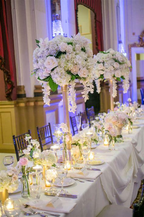 tall gold candelabra flower centerpieces