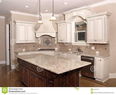 luxury kitchen with granite island and window stock image