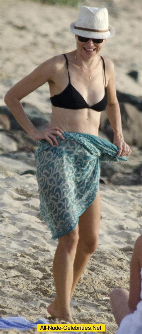 Naomi Watts in black bikini on the beach in Barbados