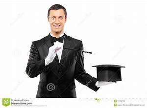 A Magician Holding A Top Hat And Magic Wand Stock Photo ...