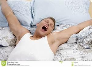 Yawning Man Stretching His Arms Stock Photo - Image: 7420570