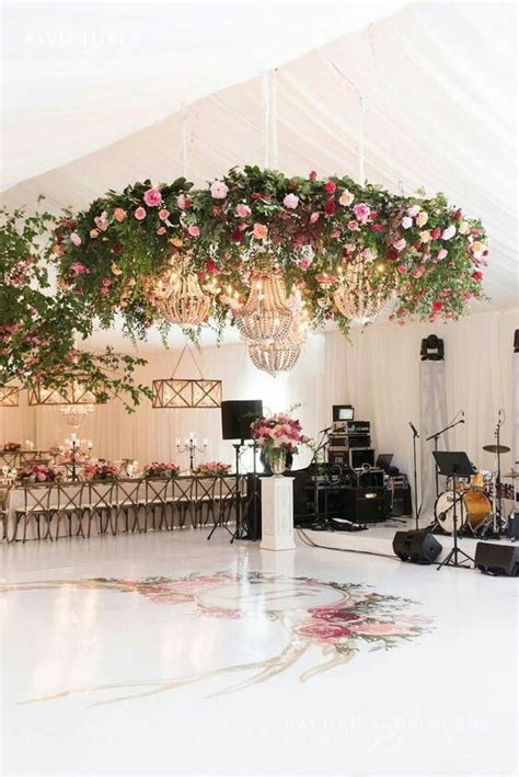 Gold Crystal Hanging Chandeliers With Lush Greenery And