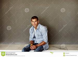 Stock photo smart young guy sitting comfortably on floor for How to sit comfortably on the floor