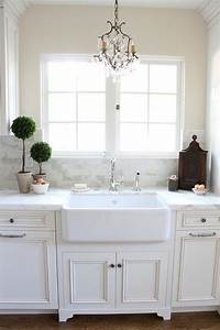 white kitchen cabinets with raised panel doors With kitchen colors with white cabinets with large chandelier wall art