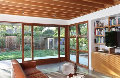 large sliding glass doors within a wooden frame decoist