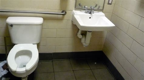 spy men toilet virginia man sues starbucks for bathroom spy cam abc news