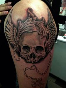 Mens' shoulder skull tattoo - TattooMagz