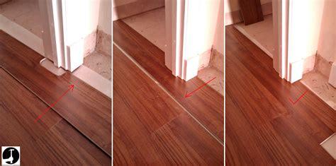 laminate plank flooring laying laminate in a doorway