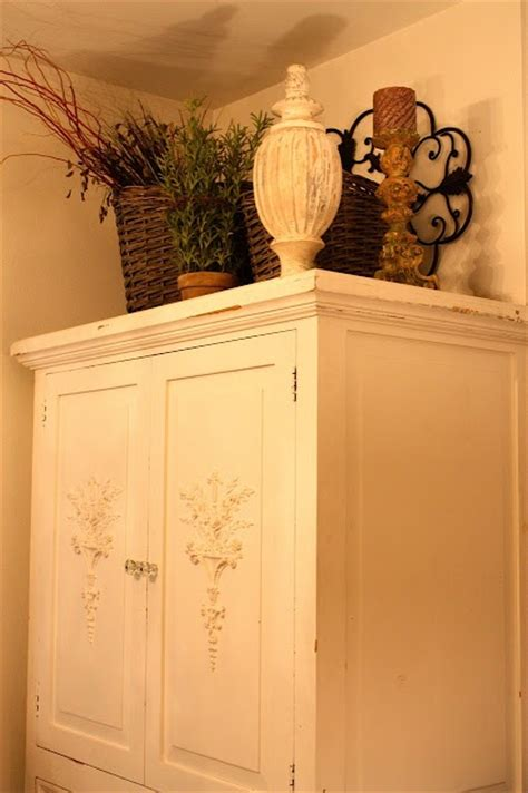 Decorating Ideas Top Of Armoire by 25 Best Ideas About Armoire Decorating On