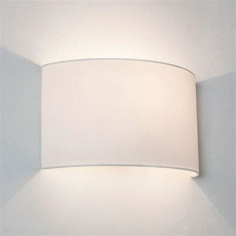 wall washer style wall light with white curved fabric shade