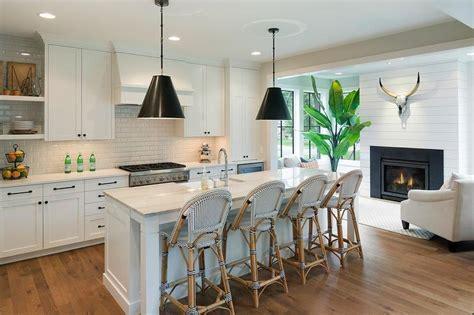 black cone light pendants  white center island transitional kitchen