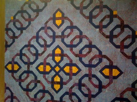 i pieced this using a celtic knot piecing design to emulate a wedding ring pattern it became a