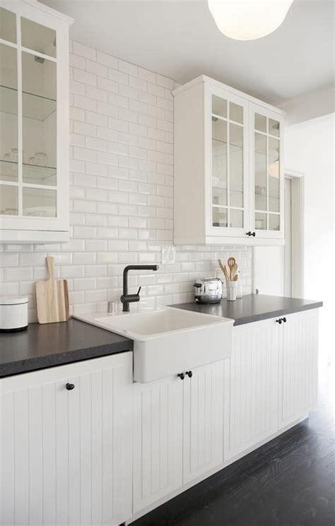 white beadboard kitchen cabinets  beveled subway