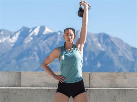 kettlebell workouts workout kettlebells woman holding