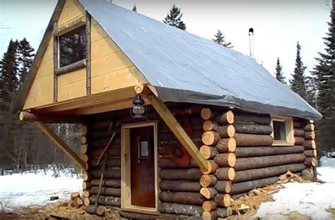 guy built  impressive log cabin