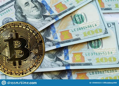 The currency began use in 2009 when its implementation was released as. Golden Bitcoins On US Dollars. Digital Currency Close-up ...