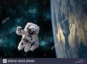 An artist's depiction of an astronaut floating in space ...