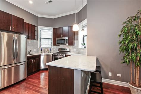 I do not like my current floors, they look orange. CHICAGO, IL in 2019 | Grey kitchen walls, Cherry wood ...