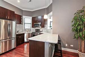 gray walls with cherry wood furniture 862