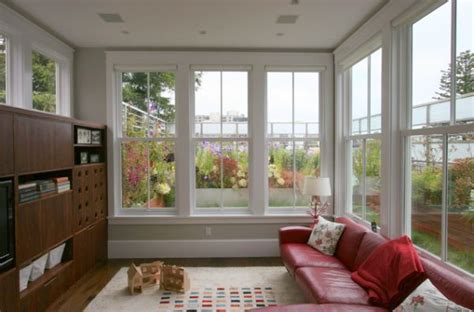 sunroom windows that open how to decorate a living room with large windows