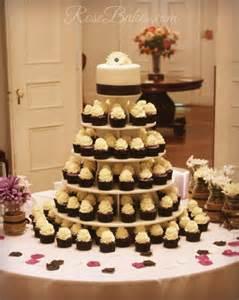black white purple wedding cake and cupcake tower