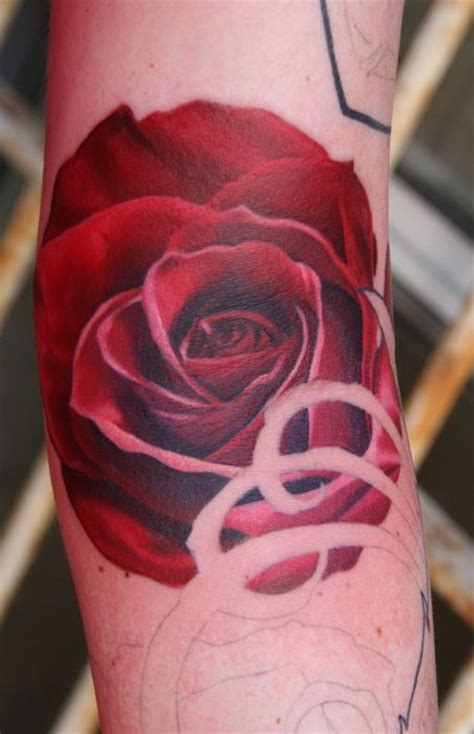 red simple rose tattoo  arm