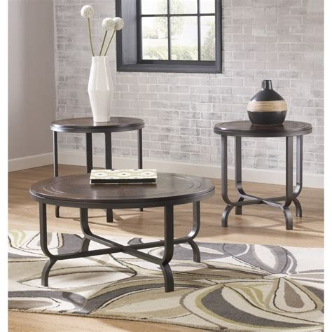 Larger end table with tempered glass insert. Ashley Furniture Ferlin 3 Piece Round Coffee Table Set in Dark Brown - T238-13