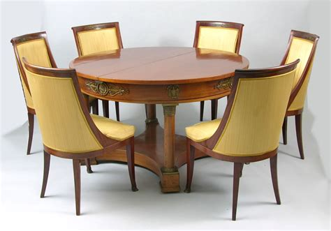 an empire style dining table and six chairs ca 19th
