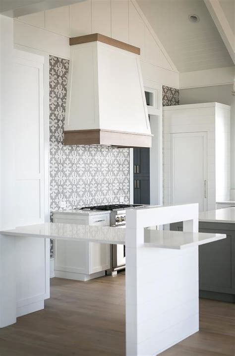 white kitchen  gray island  dark oak wood floors