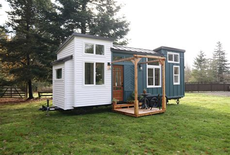 28ft pacific getaway tiny house with transforming bedroom dining room built by handcrafted