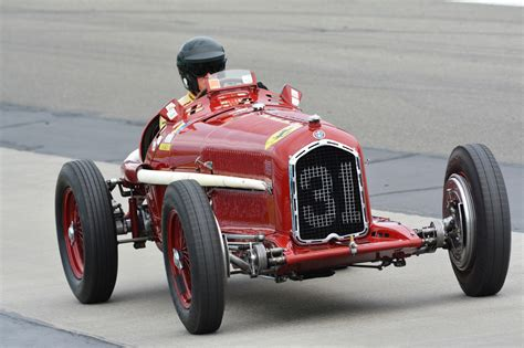 At Indy Course, Vintage Race Cars Take You On A Roll Down