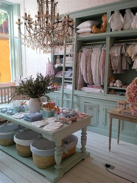 the shabby chic boutique piccoli co store minus the chandelier i want my shop to be quite empty inspite of all the