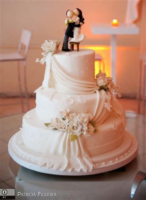 tier white wedding cake  drape  kissing bride