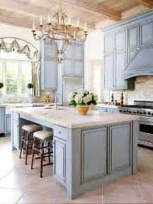 french country kitchen limestone marble beamed ceiling pale blue cabinets arched window