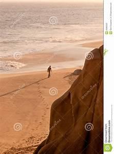 Man Walking On Beach Alone Stock Photos - Image: 25082523