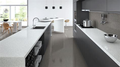 white benchtop cupboards tiles and splashback