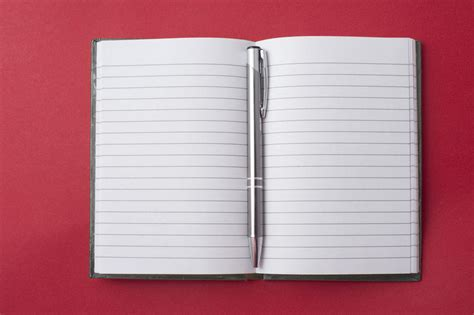 Free Stock Photo 5363 Opened Notebook With A Pen In The Centre Freeimageslive